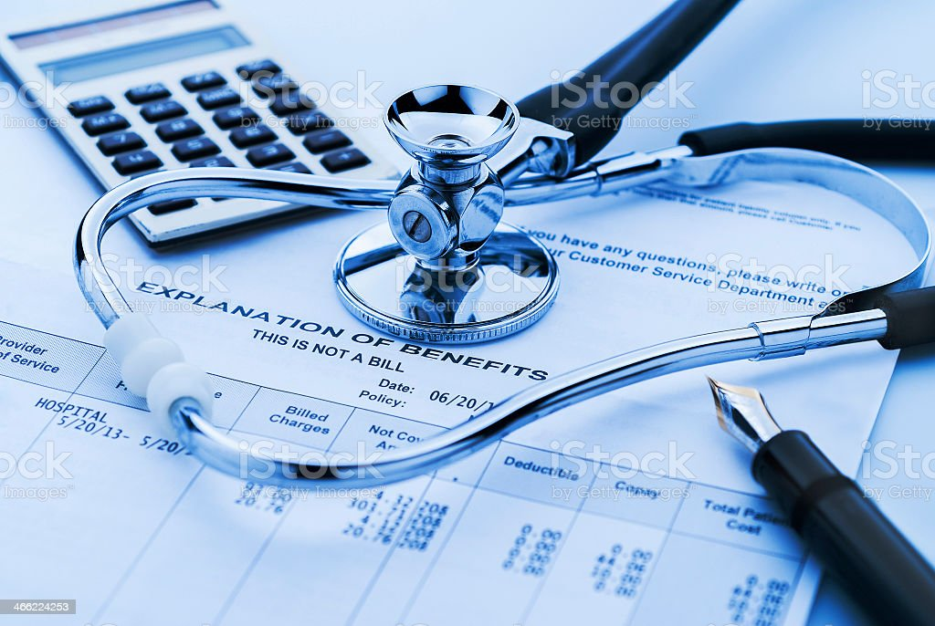 Gloomy image of healthcare costs and a stethoscope stock photo