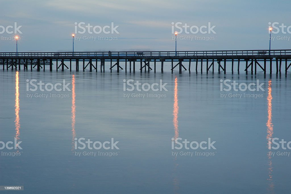 Gloomy pier - long exposure stock photo