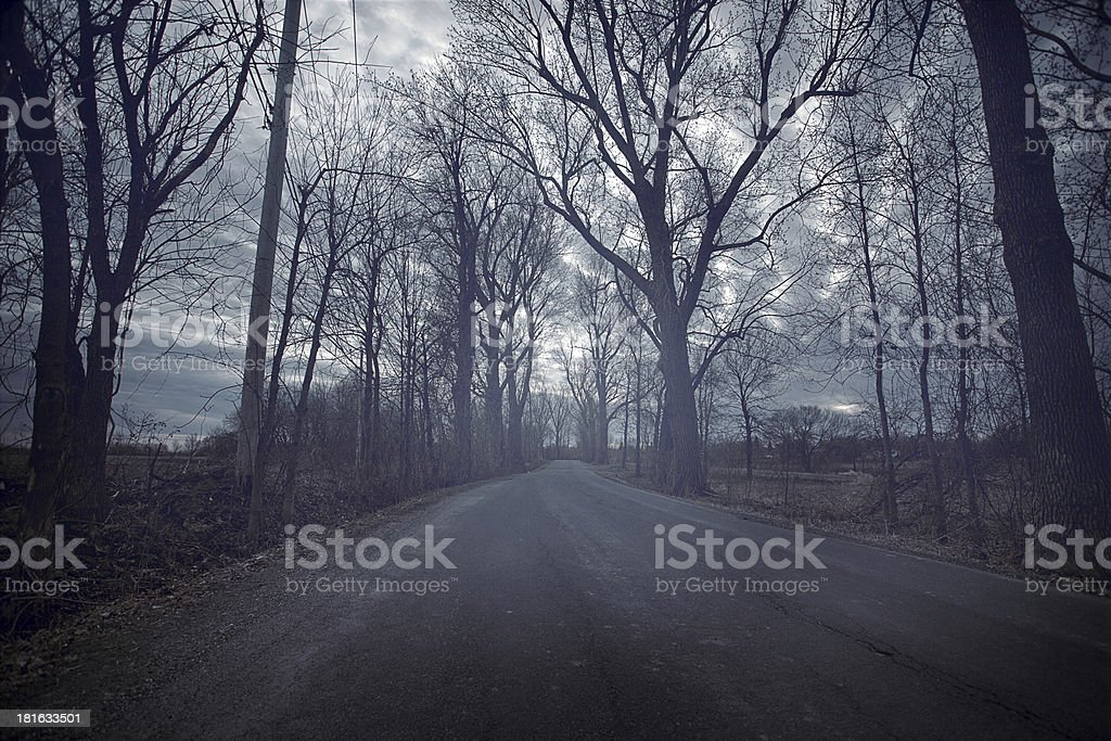 Gloomy road durring a cold day of Autumn royalty-free stock photo