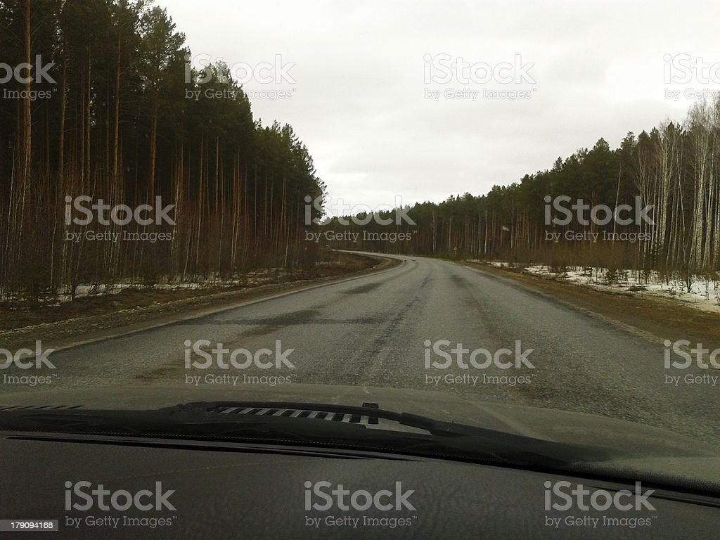 Gloomy sky, nontrafffic highway and the hood of car royalty-free stock photo
