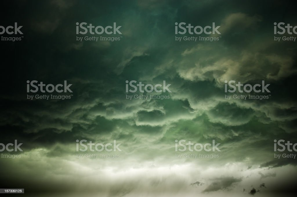 Gloomy storm clouds rolling in stock photo