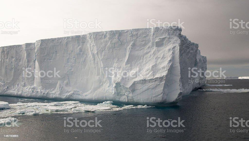 Gloomy tabular iceberg stock photo