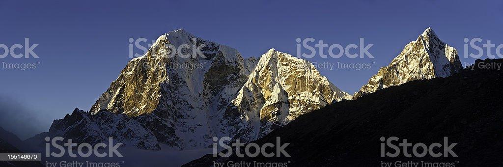 Glorious summit sunrise snow capped peaks pinnacles panorama Himalayas Nepal royalty-free stock photo