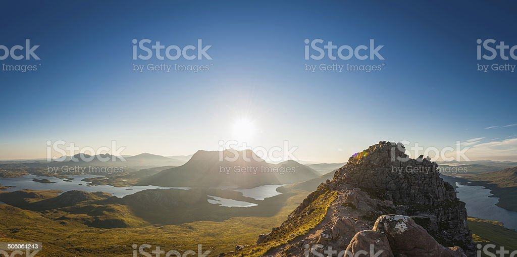 Glorious sunrise over mountain peaks wilderness panorama Highlands Scotland stock photo