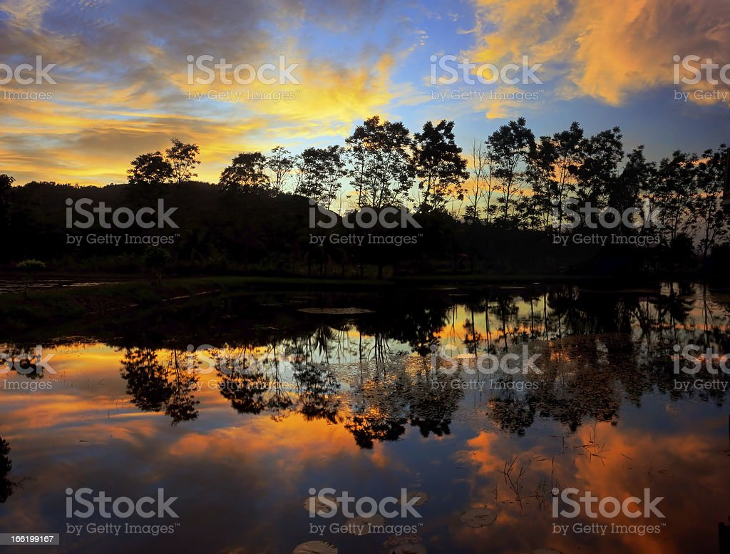 Glorious sunset colors reflected on the lake royalty-free stock photo