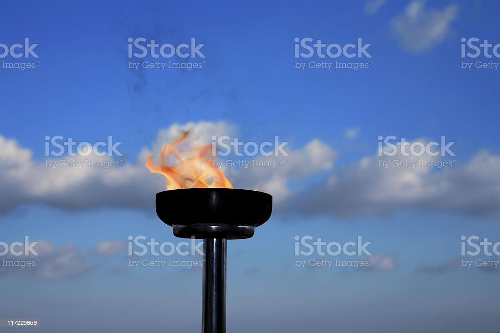 glory burning torch stock photo