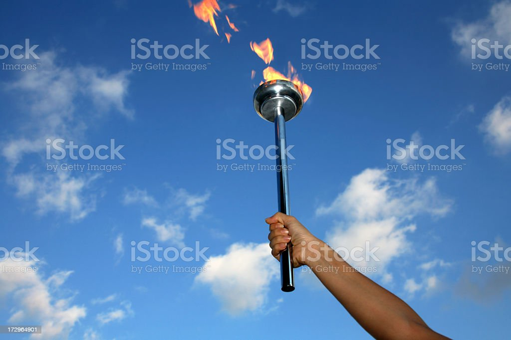 glory of holding flaming torch stock photo