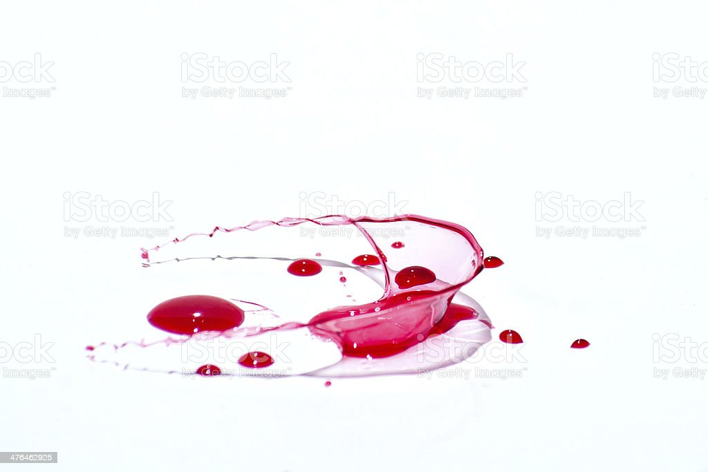Glossy red liquid droplets (splatters) isolated on white stock photo