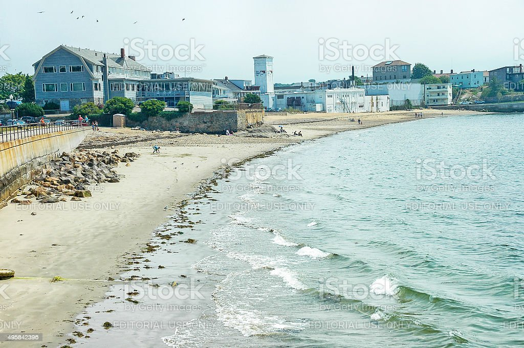 Gloucester Massachusetts Water Front with people on beach stock photo