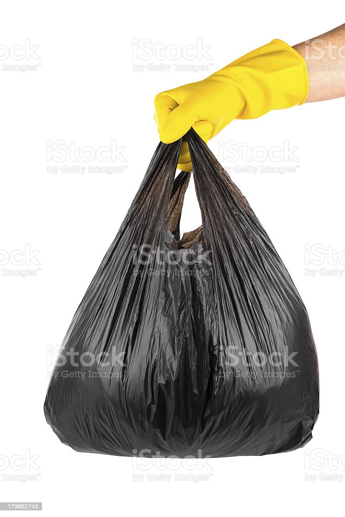 glove holding Garbage and trash bag isolated on white background stock photo