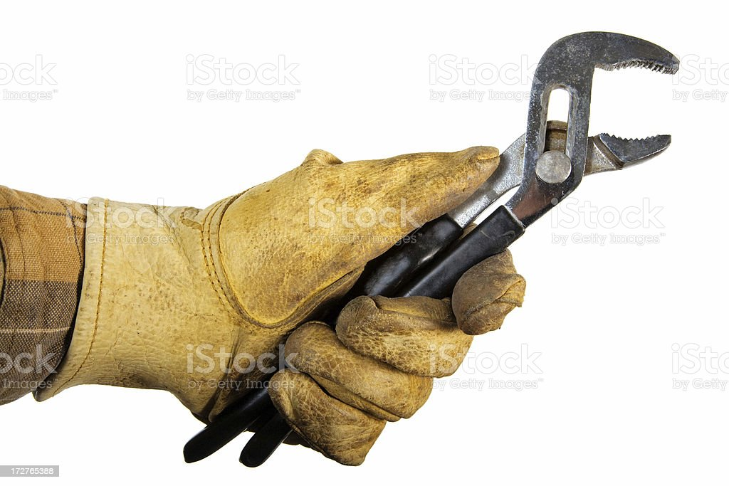 A glove protected hand holding pliers. royalty-free stock photo