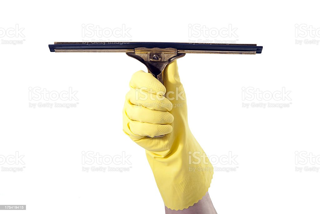 gloved hand holding a squeegee stock photo