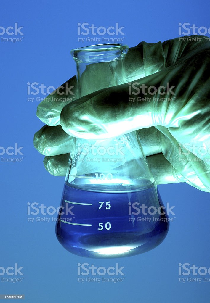 Gloved Hand Holding Flask royalty-free stock photo