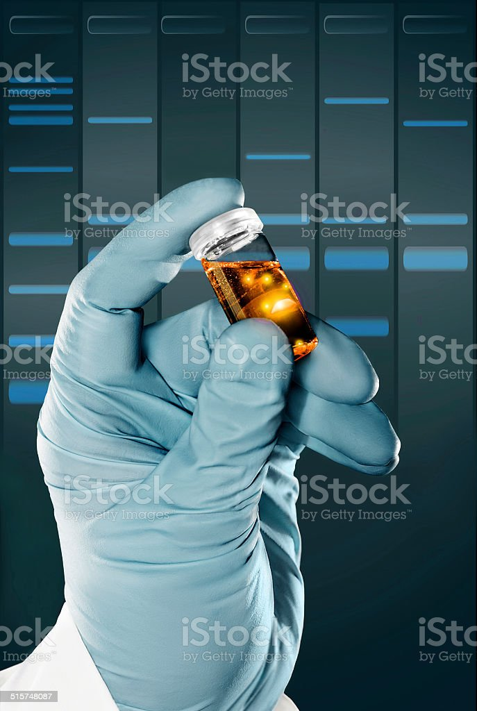 Gloved hand holds a liquid sample in plastic vial stock photo