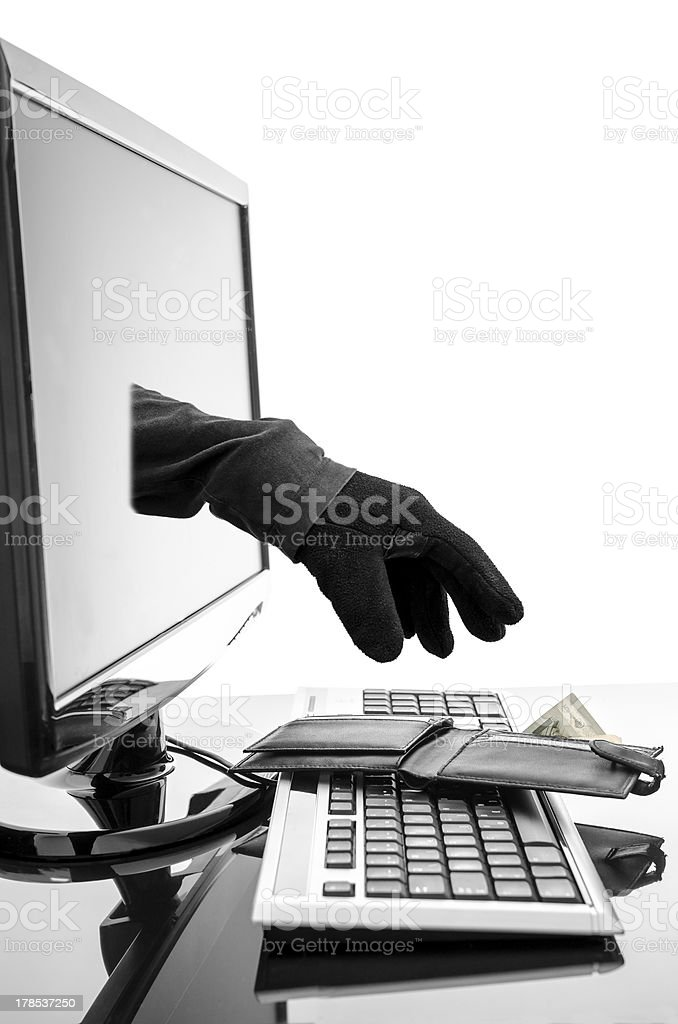 Gloved hand stealing wallet through a computer screen royalty-free stock photo