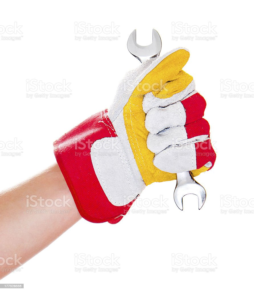 gloved hand with wrench royalty-free stock photo