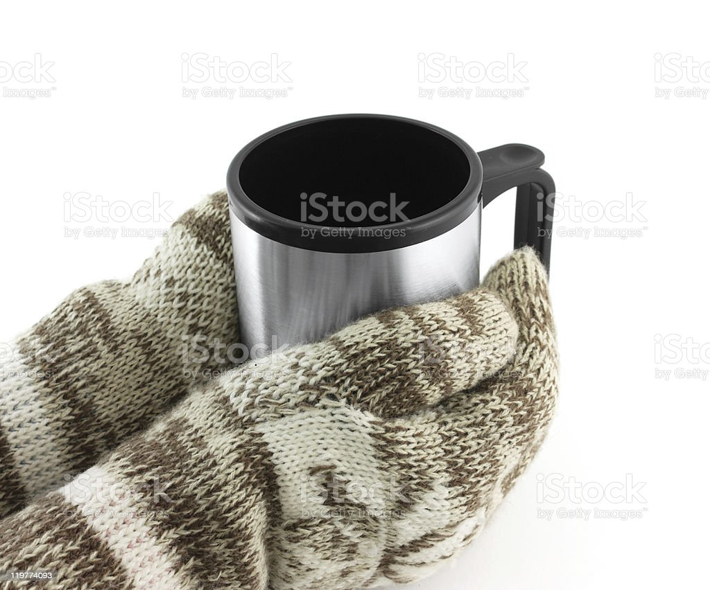 Gloved hands holding a travel mug royalty-free stock photo