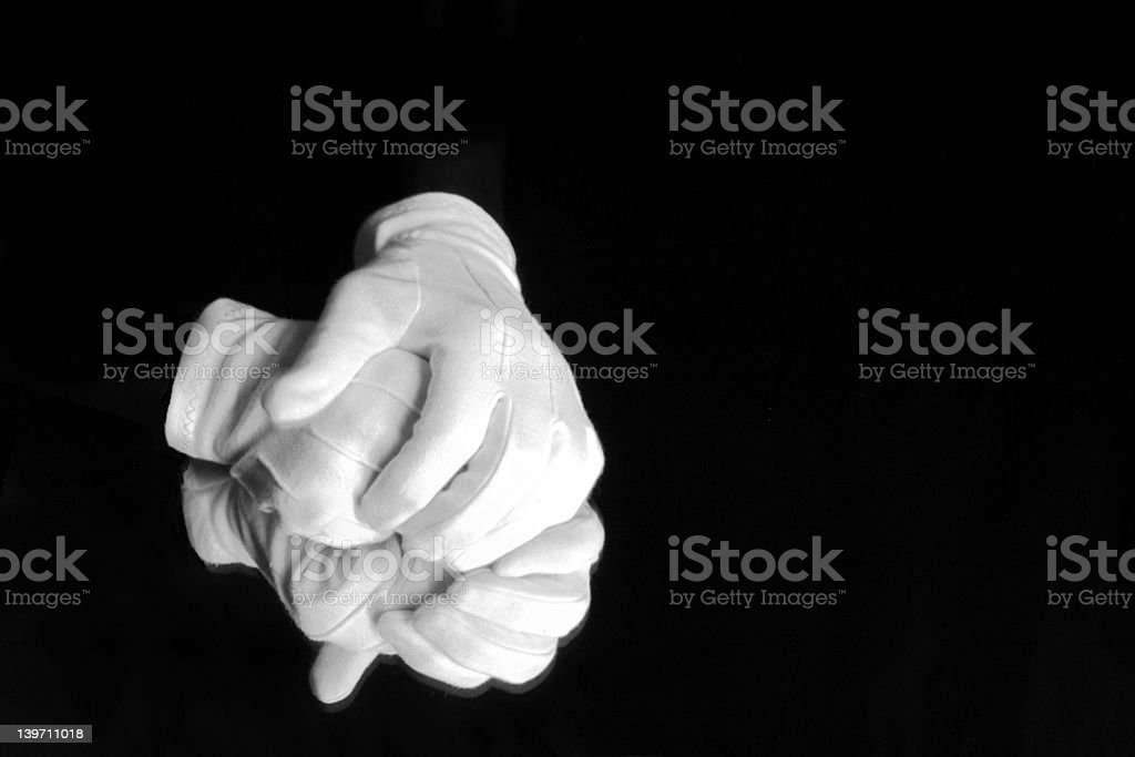gloved hands on mirror royalty-free stock photo