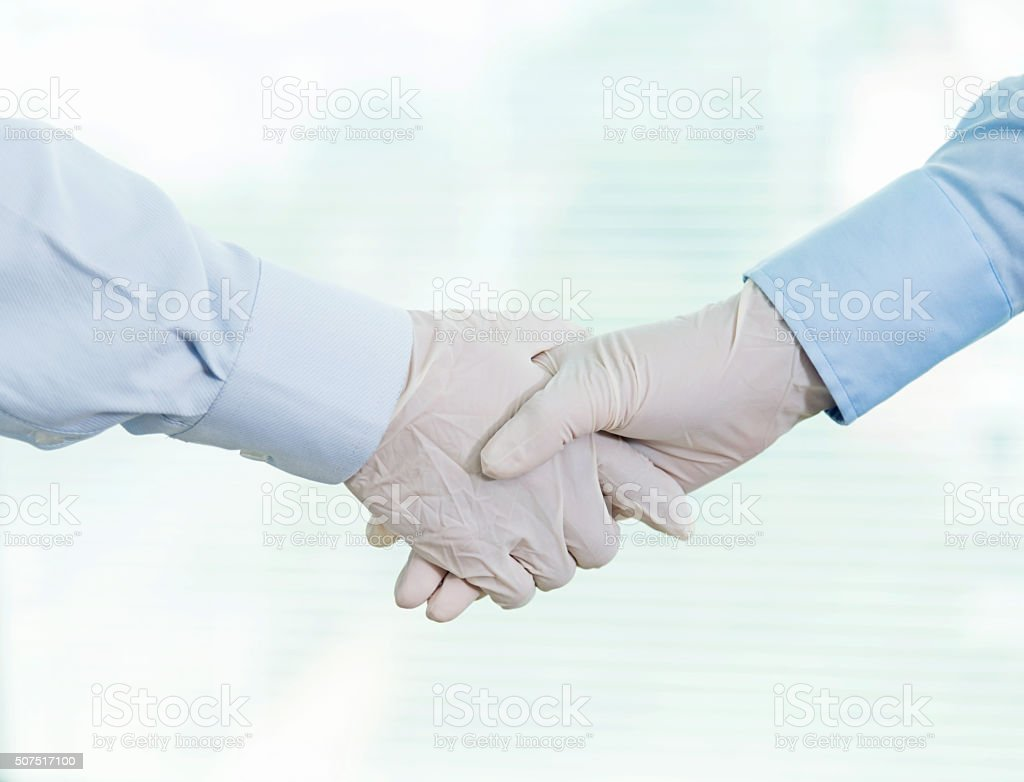 Gloved handshake stock photo