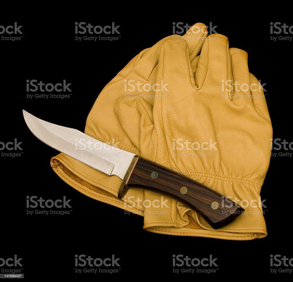 Luvas e uma faca. foto royalty-free