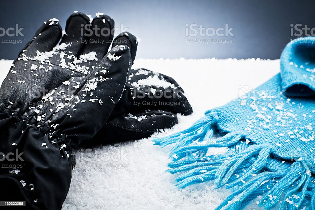 Gloves and a scarf over the snow royalty-free stock photo