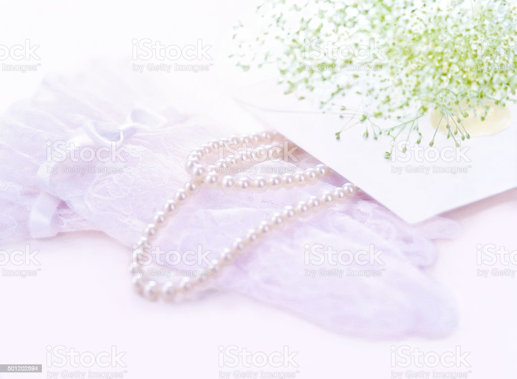 gloves and pearl stock photo
