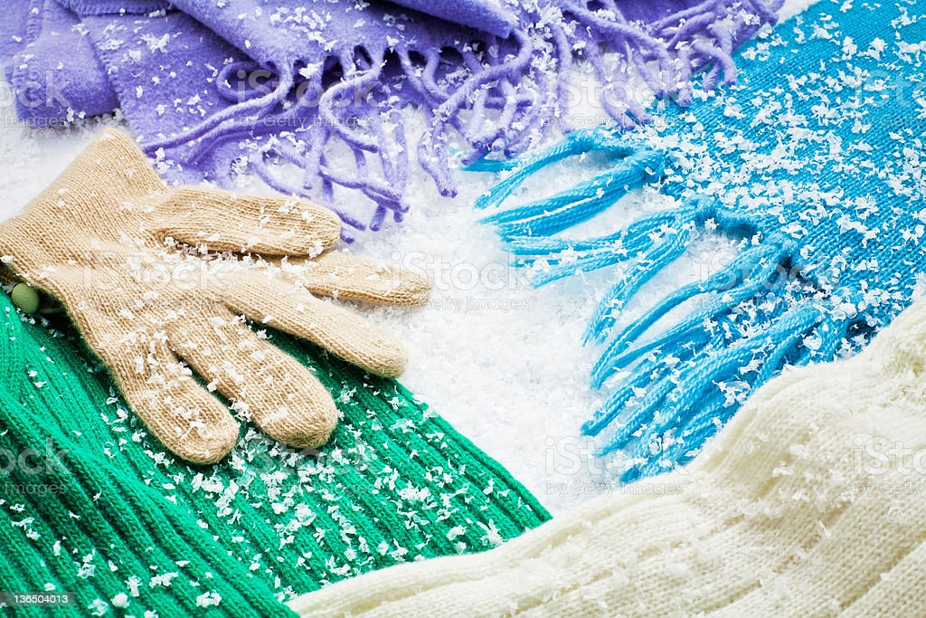 gloves and scarves of wool over the snow royalty-free stock photo