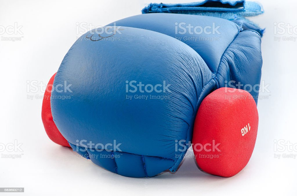 gloves for martial arts with dumbbell stock photo