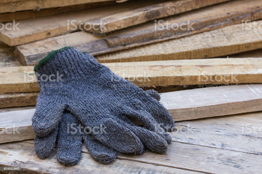 Gloves on wooden table stock photo
