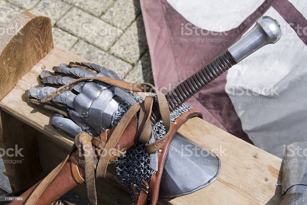 Gloves, sword and chain armour royalty-free stock photo