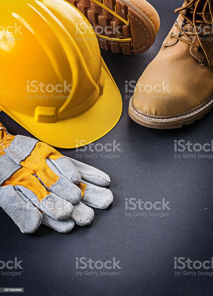 gloves yellow helmet working boots stock photo