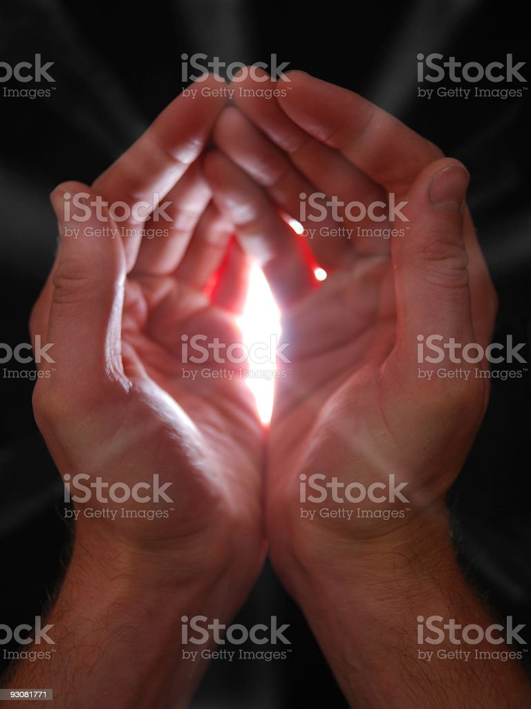 Glow eminating from male cupped hands royalty-free stock photo