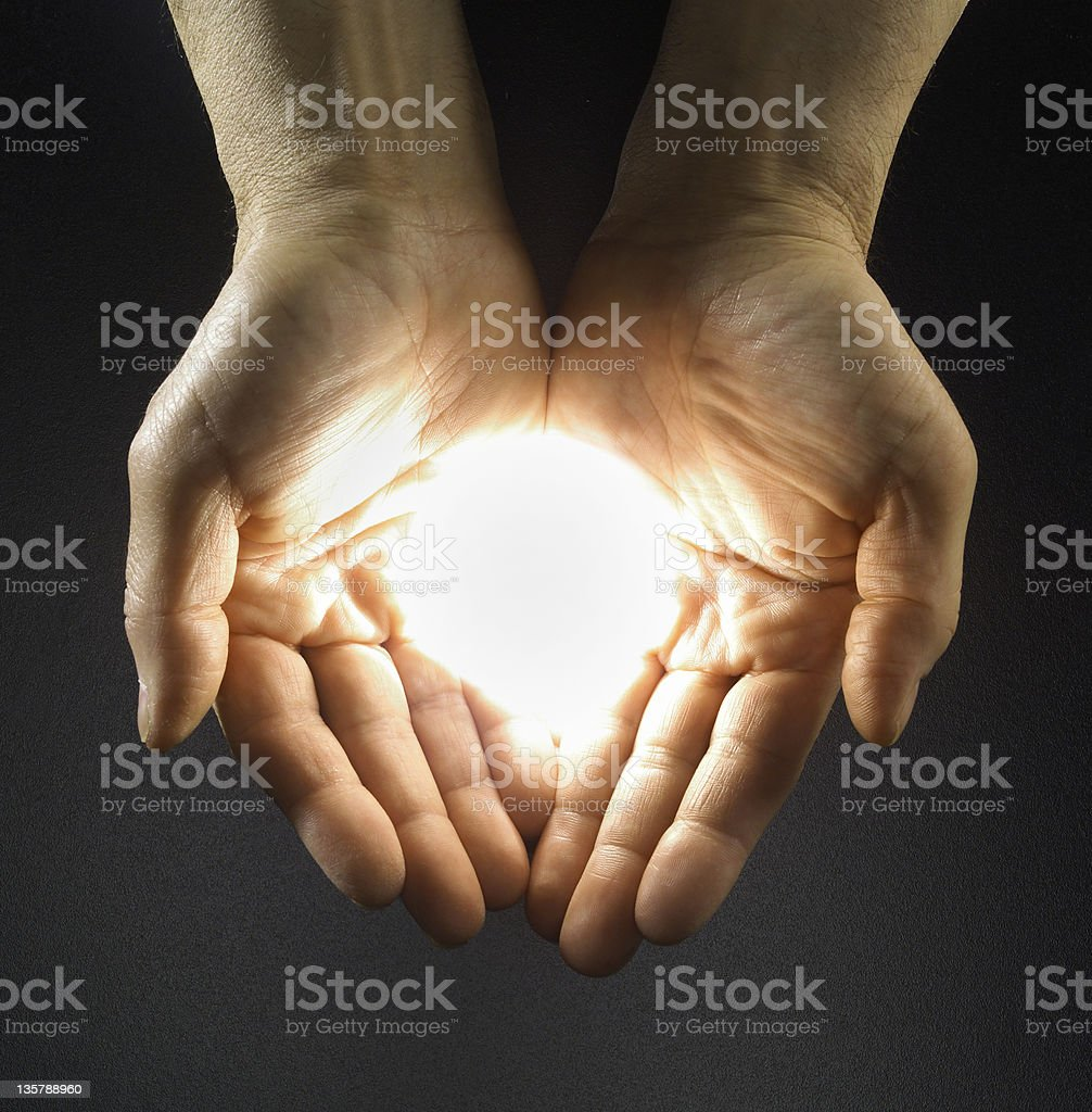 Glow in hand - overhead of man's hands with lighted glow royalty-free stock photo