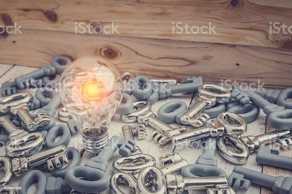 glow light bulb with heaps of keys stock photo