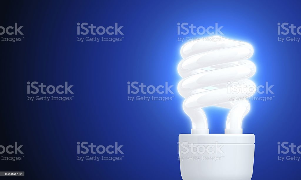 Glow of Compact Fluorescent LightBulb (On Blue) royalty-free stock photo