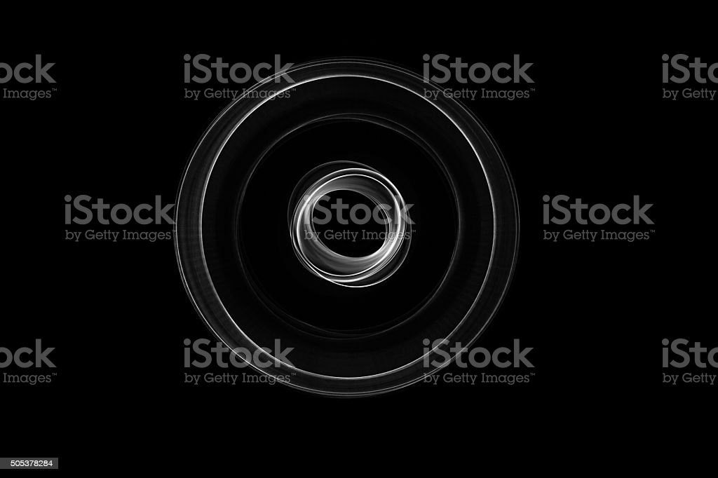 Glowing abstract curved black and white lines stock photo