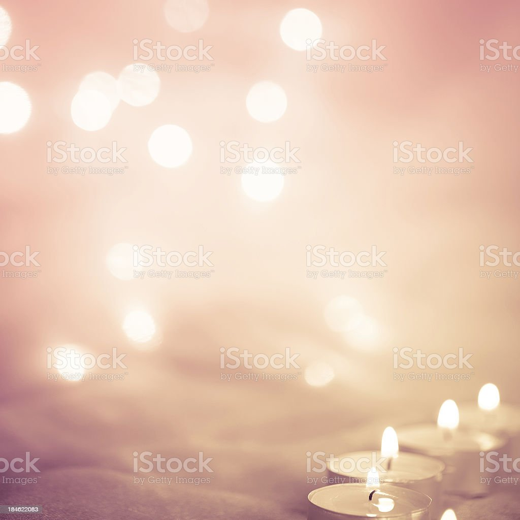 Glowing background with candle lights royalty-free stock photo