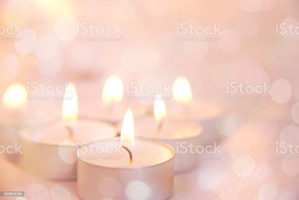 Glowing background with candle lights stock photo