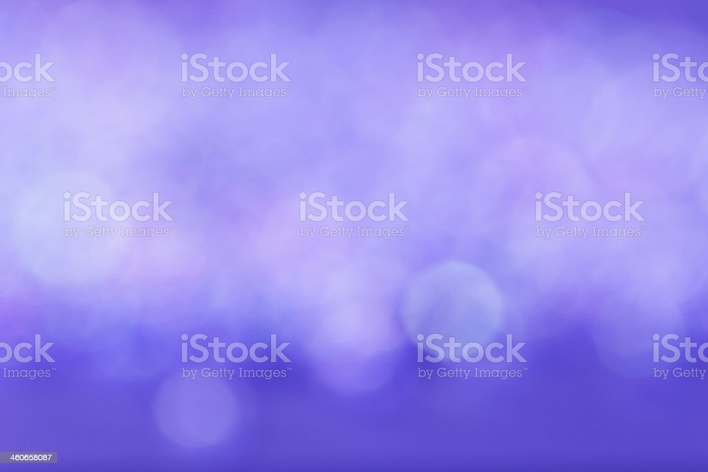 A glowing, blurred violet background royalty-free stock photo