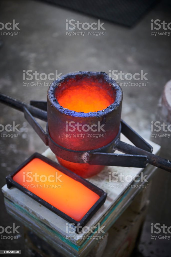 Glowing bronze filled into shape to make a bar stock photo