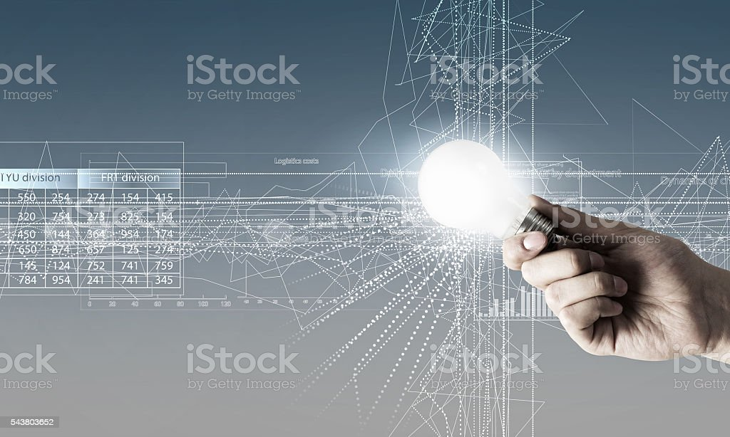 Glowing bulb in hand stock photo