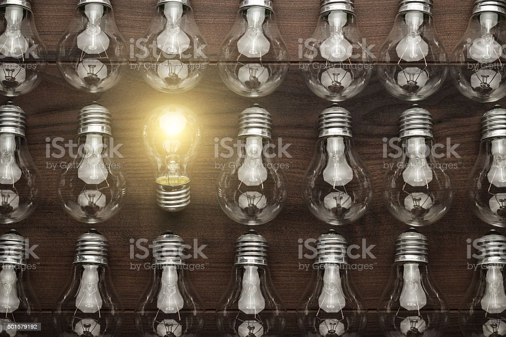 glowing bulb uniqueness concept stock photo