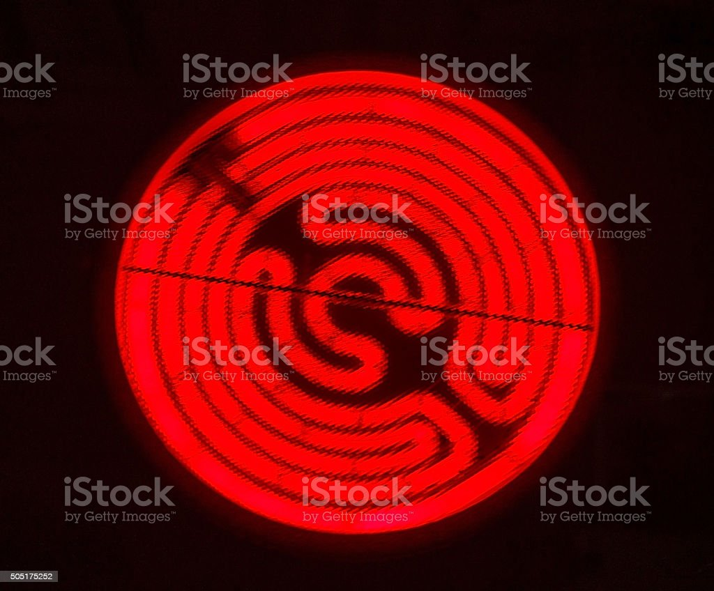Glowing burner of the electric hotplate stock photo