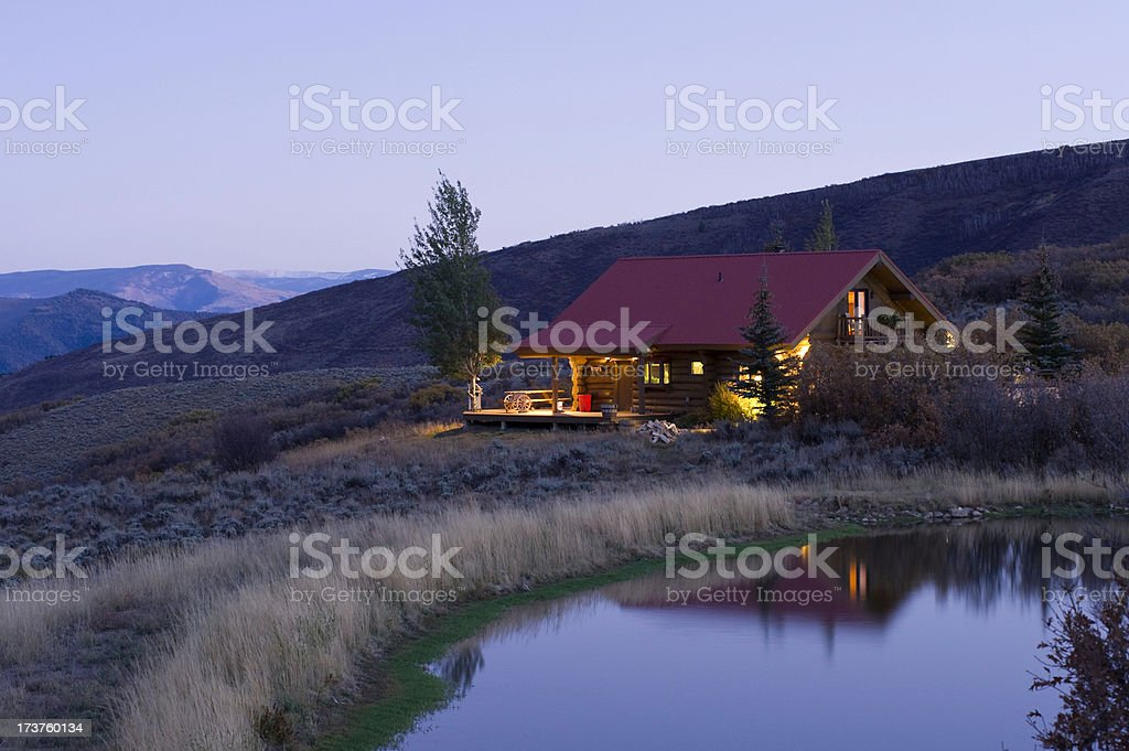 Glowing Cabin in the Mountains stock photo