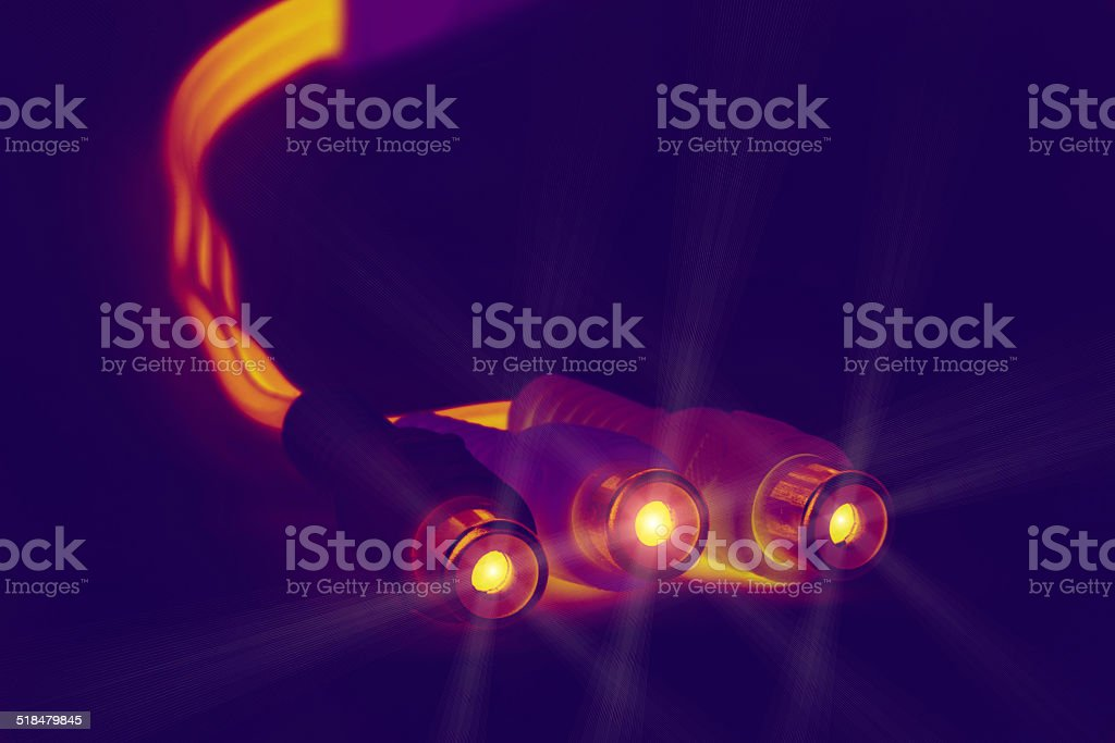 Glowing cable plugs stock photo
