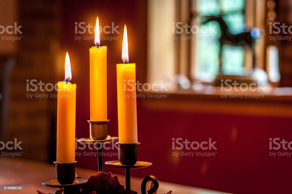 glowing candles on a table stock photo