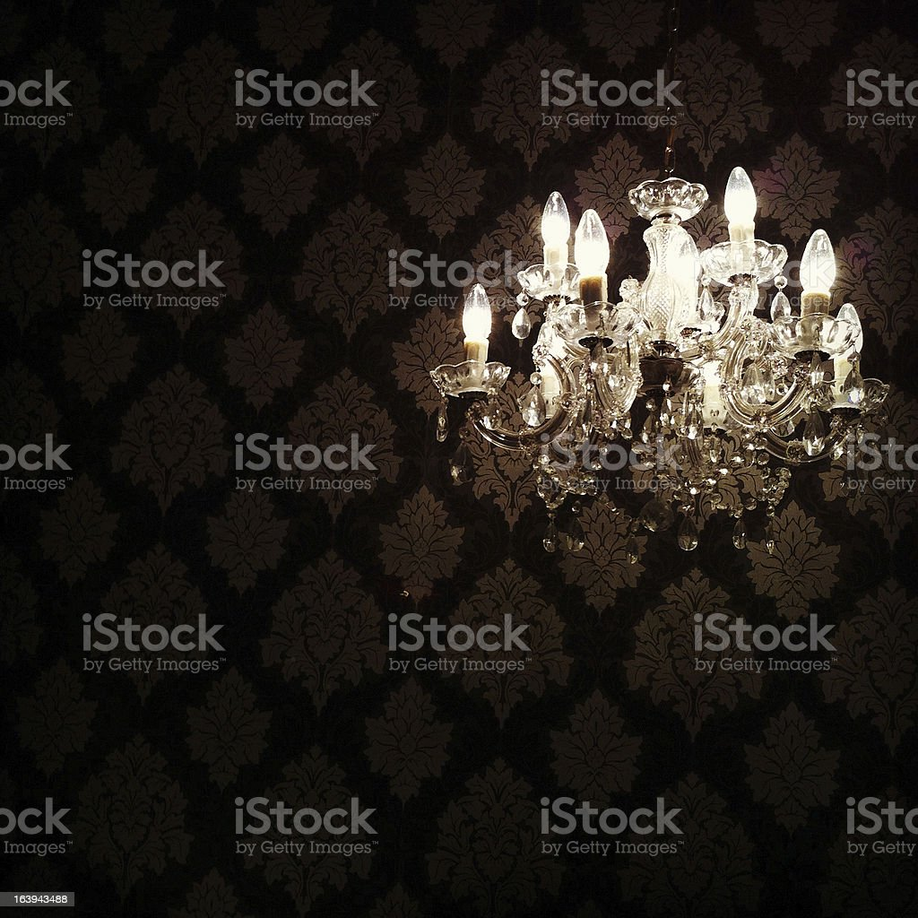 Glowing Chandelier Hanging in Darkness stock photo