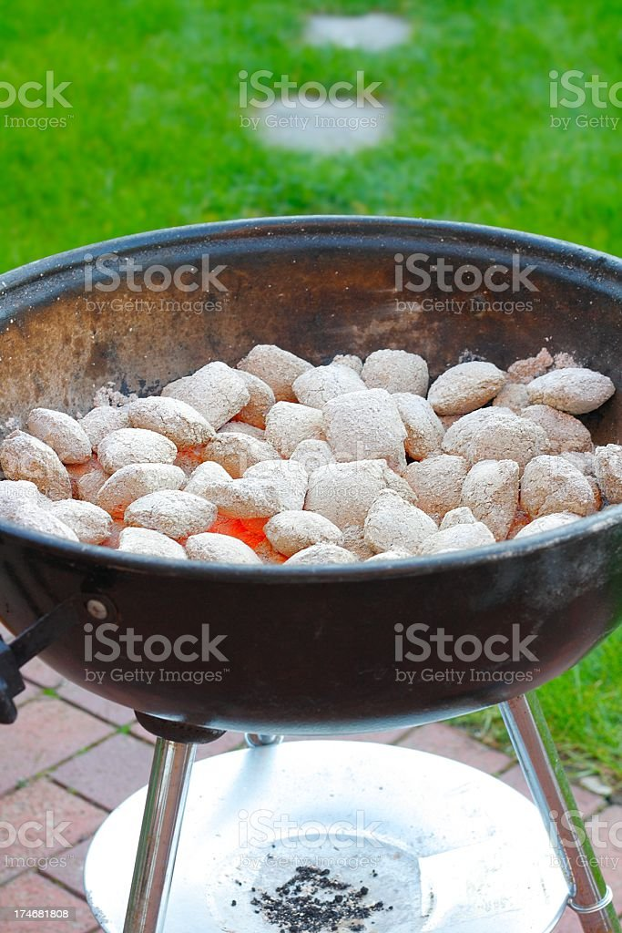 glowing charcoal briquets stock photo