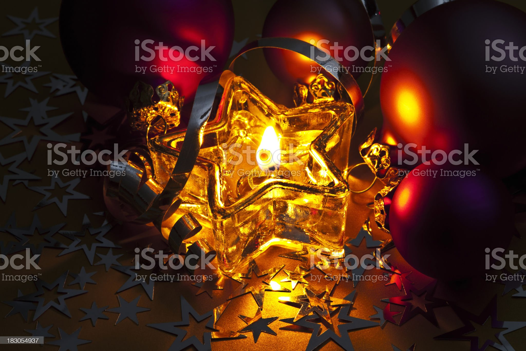 Glowing Christmas Candle, Baubles, Stars, Ribbons royalty-free stock photo