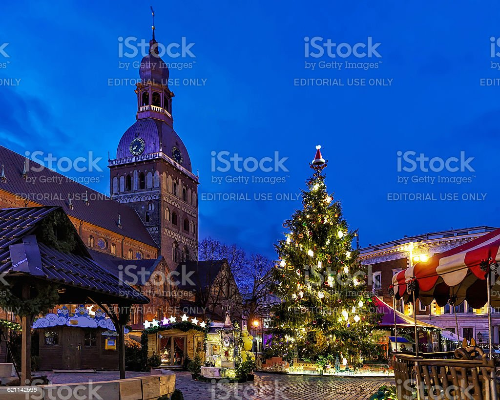 Glowing Christmas tree at the market near Riga Cathedral stock photo